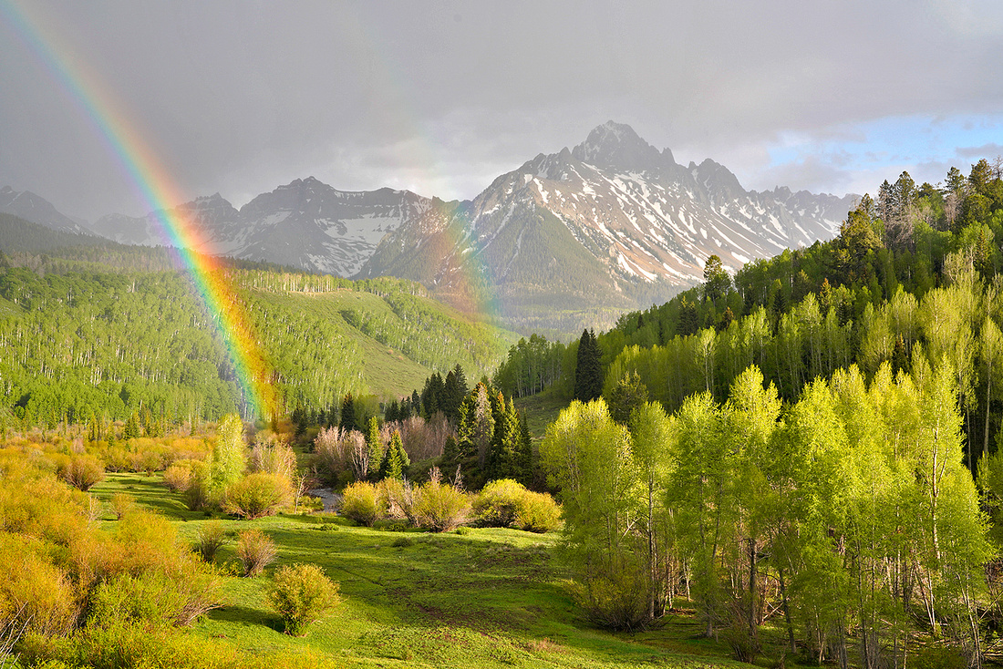 Mount Sneffels and rainbow in spring 2